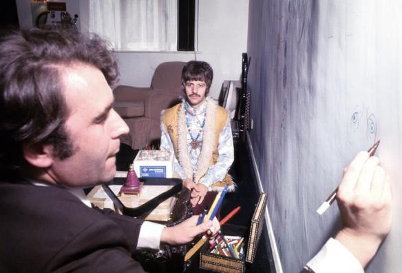 Cartoonist Gerald Scarfe sketches Ringo Starr in 1967, drawing directly onto the wall of Ringo's gameroom. (Henry Grossman)