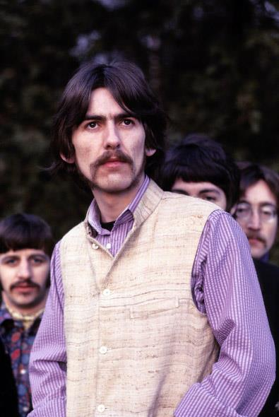 George Harrison poses with the Beatles during a photo shoot at Ringo's house for Life Magazine in 1967. (Henry Grossman)