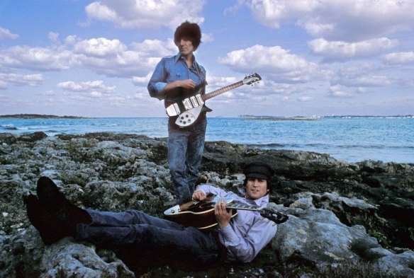 George Harrison stands and John Lennon lays down during the filming of Help in the Bahamas. (Henry Grossman)