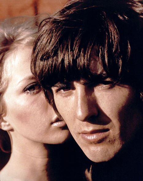 George Harrison with girlfriend and later wife, Pattie Boyd, 1965. (Henry Grossman)