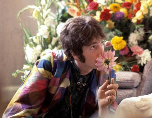 John Lennon sniffs a flower while visiting Maharishi Mahesh Yogi, 1967. (Henry Grossman)