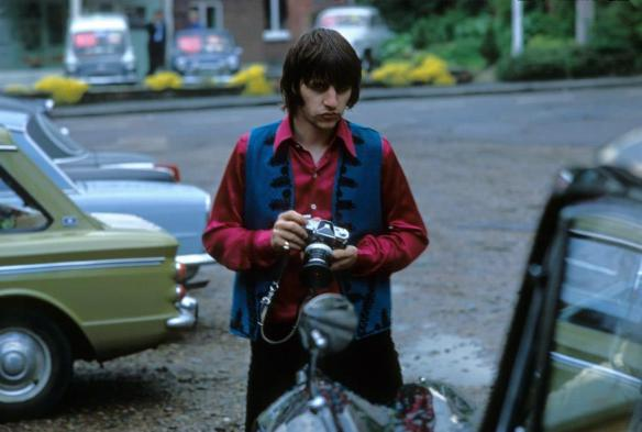 Ringo Starr holds a cameras in 1968. (Henry Grossman)