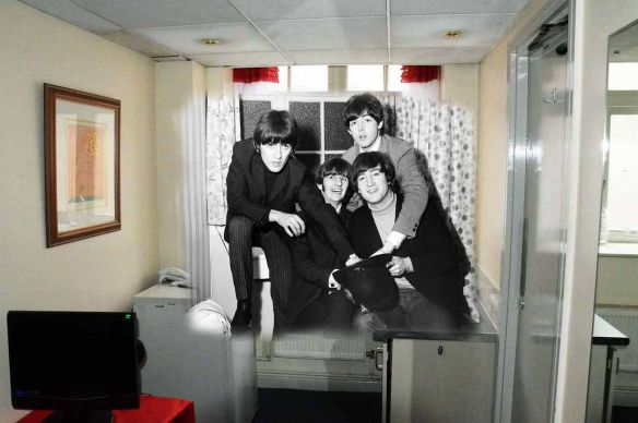 Then, Now and Together - The Beatles in Liverpool. We have taken a new picture from the same position as the old one. We have then superimposed the old picture onto the new one to 'ghost' the complete image