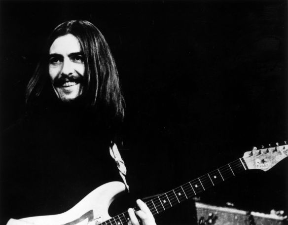 George Harrison - 1943 - 2001 George on stage - 3th December 1969 (of the Beatles at a concert in Copenhagen with Eric Clapton and Delaney and Bonnie. (Photo by Keystone/Getty Images)